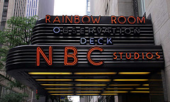The Rainbow Room's Retro Sign Jutting Out The Side Of The Building.