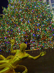Colorful Lights And Gold Statue Located In Rockefeller Center Between 48th And 51st Streets In New York City.