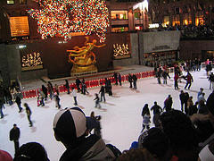 Ice Skaters Enjoying An Evening At The Rockefeller Center In Midtown Manhattan.