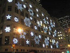 Saks Fifth Avenue Being Snowed On By An Eye Catching Light Display.