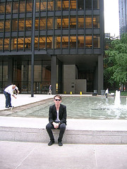 A Man Poses In Front Of The Fountain Of The Seagram Building.