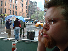 A Man Talks On His Cell Phone Near Second Avenue
