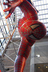 A Close Up Of Spiderman Wall Walking Inside The Sony Building