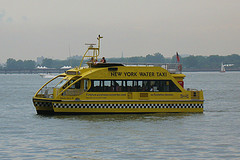The South Ferry (Manhattan) Water Taxi Carrying Passengers To Staten Island
