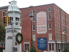 The South Street Seaport With Its Museum In The Back Ground And Light Tower