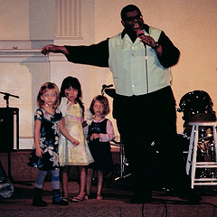 A Fine Photo From The St. Mark's Church In-the-bowery With Some Children A Black Man Singing