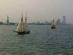 Boating Enthusiasts Enjoy The Waters Of New York Harbor Around The Statue Of Liberty.
