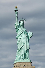 The Statue Of Liberty Raises Her Torch In Welcome