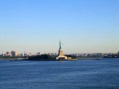 Statue Of Liberty Seen From A Distance On A Sunny Day