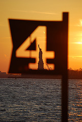 Unique View Of The Statue Of Liberty At Sunset.