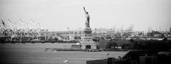 A Very Old Shot Of The Statue Of Liberty In A Black And White Photo