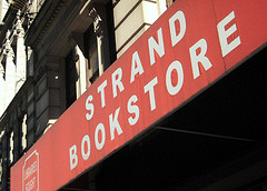 The Old Weathered Sign Outside The Strand Bookstore