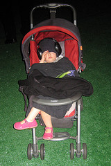 A Tuckered Out Child Taking An Evening Nap At The Tavern On The Green.