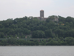 A Cloudy Gray Day On The Hudson River Passing By The Cloisters Museum, Famous For Its Middle Ages Art.