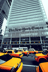 A Perfect Pair, The New York Times Building And A Street Full Of Taxi Cabs.