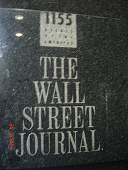 Photo Captures The Sign Outside Of The Wall Street Journal