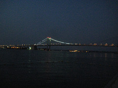 The Throngs Neck Bridge Lit Up At Night Almost As Bright As The Fire That Took Place During Its Construction.
