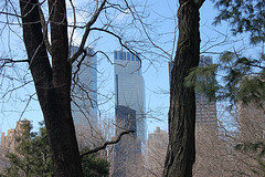 A Haunting View Of The Time Warner Building Taken From Behind Trees In A Nearby Park