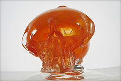 Orange Skull Glass Art Piece On Display At The Time Warner Center