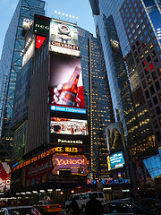 Jumbo Advertising Signs Dominate The Night In New York's Times Square.