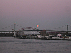 A Shot From The River Of Both The Triborough Bridge And Hell Gate Bridge During A Red Moon