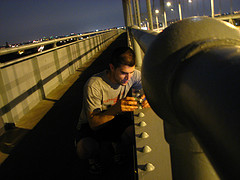 A Man Stands On The John F. Kennedy Bridge Formerly Called The Triborough Bridge