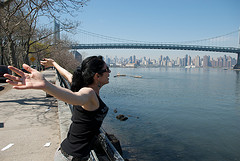 Woman With The Triborough Bridge And New York City In The Background