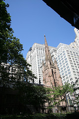 Trinity Church In Lower Manhattan With Buildings On Broadway In The Background