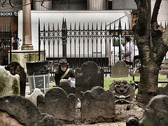 Woman Paying Respects At Grave Sight In Trinity Church Cemetery In Manhattan.