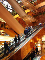 A Group Of People Going Up On The Escalators At New York's Trump Tower