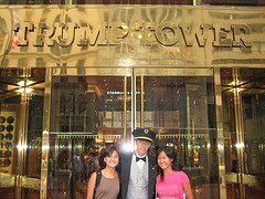 Two Women And A Bellhop Pose For A Photo At The Trump Tower (new York)