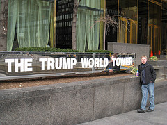 An Admirer Of Donald Trump Posing By The Sign Located At The Entrance Of The Trump World Tower