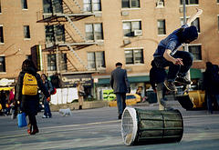 A Skateboarder Performs A Trick In Union Square Park.