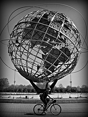 A Biker Riding Past The Unisphere, Originally Constructed For The New York World's Fair