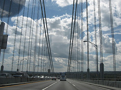 Bus And Car Crossing The Verrazano-narrows Bridge That Connects Brooklyn And Staten Island.