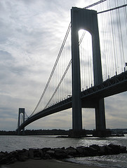 The Rocky Shore And Beautiful Waters Complement Verrazano-narrows Bridge's Beauty.