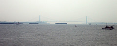 A Haze Covers The Verrazano-narrows Bridge Seen In The Distance.