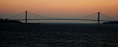 The Sunset Provides A Gorgeous Background For The Double-decked Suspension Verrazano-narrows Bridge