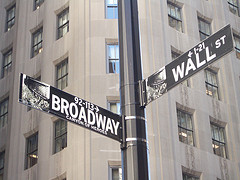Street Sign At The Corner To Wall Street And Broadway