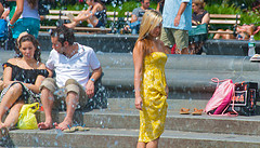 Girl In Yellow Dress Feels The Fountain Around Her In Washington Square Park