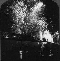 Black And White Photo Of Fireworks Over Williamsburg Bridge.