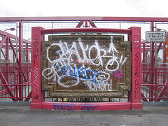 A Photo Of The Williamsburg Bridge With A Lot Of Graffiti Tagged.