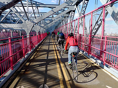Cyclists Take A Morning Ride Over The East River Via The Williamsburg Bridge.