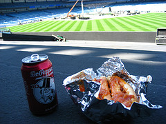 Some Grub And A Soda Can Keeping The Empty Yankee Stadium Some Company.