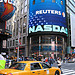 A Busy Scene In Front Of NASDAQ In Midtown